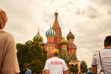 A man with t-shirt Russia in front of St Basil's Cathedral on the Red Square
