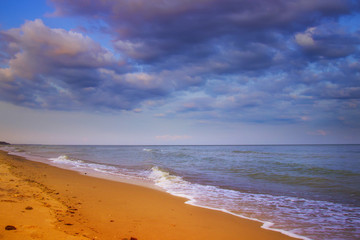 beautiful yellow sandy beach near the blue sea
