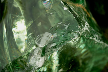 The texture is a piece of chipped green glass. Bright and beautiful