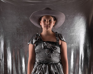young little girl in a silver dress