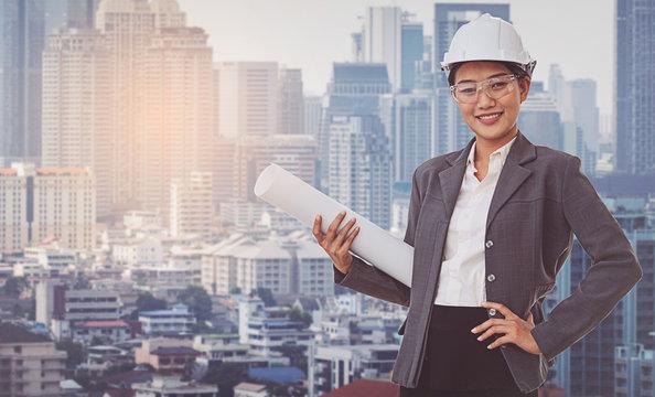 Business woman wearing white helmet