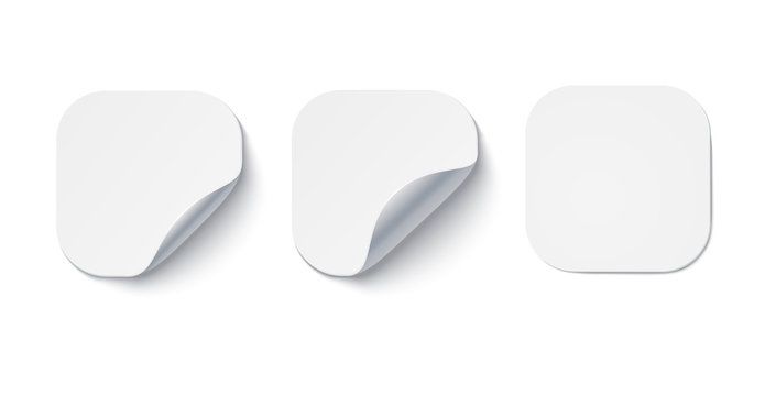 Blank white adhesive stickers with curled corners for notes. Layouts of labels, price tags.