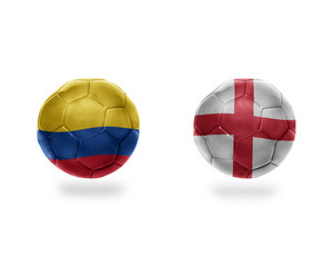 football balls with national flags of colombia and england.