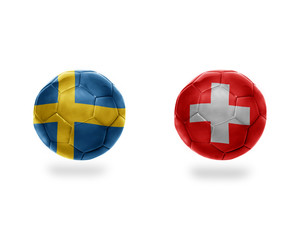 football balls with national flags of sweden and switzerland.