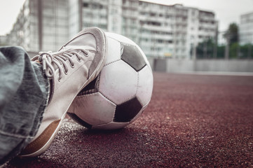 foot of a man on a soccer ball