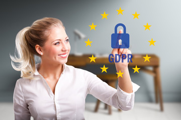 young woman is selecting GDPR in front of an office desk