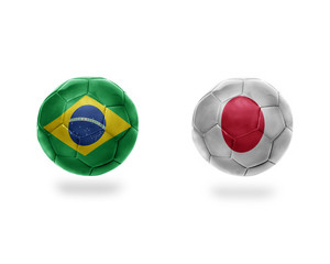 football balls with national flags of brazil and japan.3D illustration