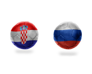 football balls with national flags of croatia and russia.