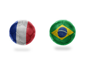 football balls with national flags of brazil and france.