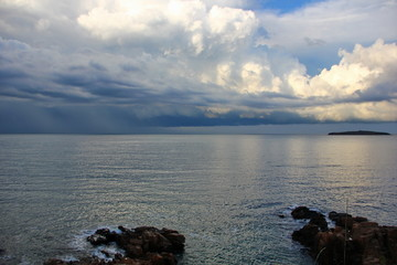 rocks, black sea and beautiful sky with cumulonimbus clouds, island, the beauty and power of nature, the moment to create a picture
