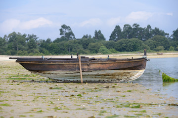 wooden fishing boat dries ashore