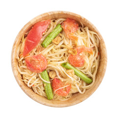 Top view Papaya salad in a wooden bowl on a white background