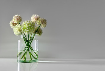Minimalistic flowers bouquet in simple glass vase
