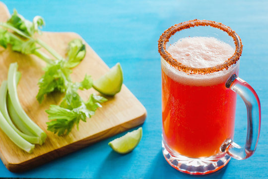Michelada beer with tomato juice, spicy sauce and lemon, mexican drink cocktail in mexico