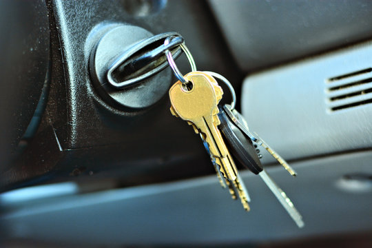 Closeup of keys dangling from a car ignition