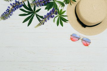 top view, straw hat, sunglasses and flowers on a white background
