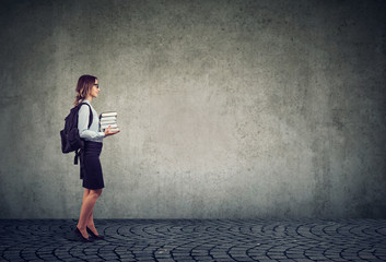 Woman with backpack and textbooks