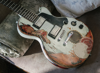 Old Guitar with distressed paint and Pin-Up Girl