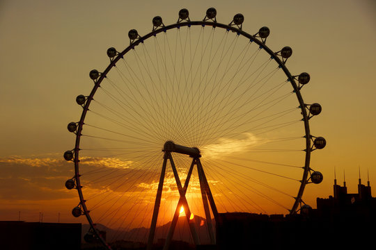 Las Vegas - June 27, 2015 - The High Roller Wheel light up at as sunrise comes through the wheel at dawn at the center of the Las Vegas Strip on June 27, 2015 in Las Vegas.