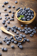 fresh blueberries in a wooden spoon