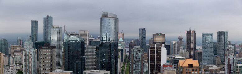 Downtown Vancouver, British Columbia, Canada - May 17, 2018: Aerial view of the modern city skyline during a rainy and cloudy day.