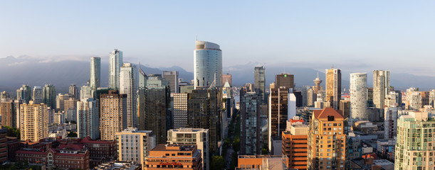 Downtown Vancouver, British Columbia, Canada - May 16, 2018: Aerial view of the modern city skyline during a sunny sunset.