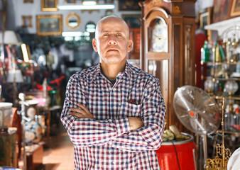 man  in interior of antique boutique