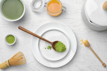 Flat lay composition with matcha tea on light background