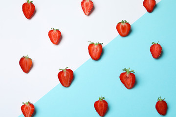 Flat lay composition with ripe strawberries on color background