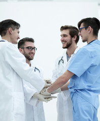 group of doctors giving a high five