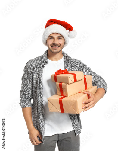 young man with christmas gifts on white background