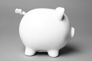 Cute white piggy bank on gray background