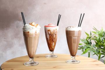 Acrylic Prints Milkshake Glasses with delicious milk shakes on table