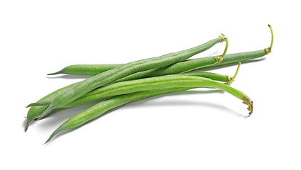 Fresh green French beans on white background