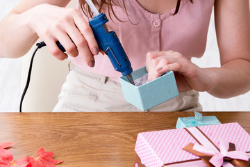 Woman decorating gift box for special occasion