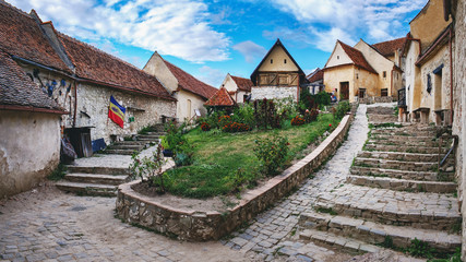 Rasnov Fortress with beautiful medieval stone houses and stone stairway, Brasov county, Romania. Panoramic view