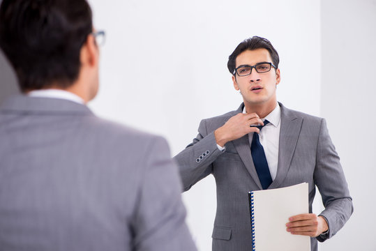 Politician planning speach in front of mirror