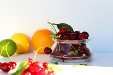 Still life of fresh berries and fruits. Vitamin supplement. Dessert for gourmets. Dietary and vegetarian dishes. Add to your diet. Side view, selective focus.