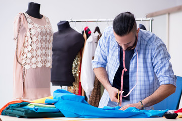 Male tailor working in the workshop on new designs