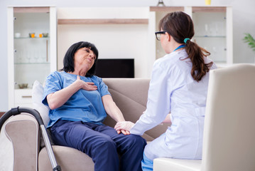 Young doctor visiting old mature woman for check-up