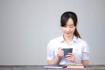 asia thai high school student uniform beautiful girl drinking coffee