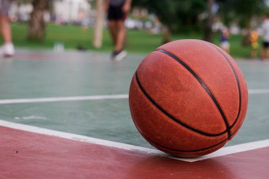 Basketball ball on corner of the outdoors court