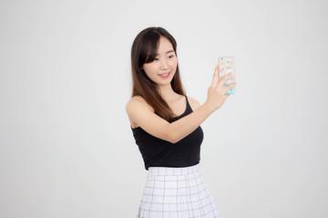 Portrait of thai adult beautiful girl using her smart phone Selfie