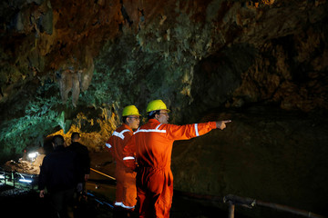 Soldiers and rescue workers work in Tham Luang cave complex, as an ongoing search for members of an under-16 soccer team and their coach continues, in the northern province of Chiang Rai