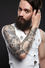handsome man with beard. Brutal bearded hipster