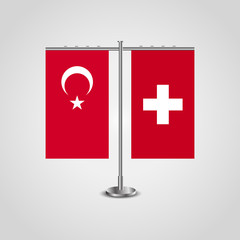 Table stand with flags of Turkey and Switzerland.Two flag. Flag pole. Symbolizing the cooperation between the two countries. Table flags