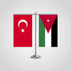Table stand with flags of Turkey and Jordan.Two flag. Flag pole. Symbolizing the cooperation between the two countries. Table flags