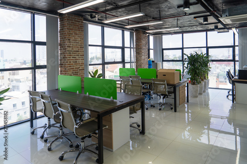 Empty room with tables in modern office open space in loft style