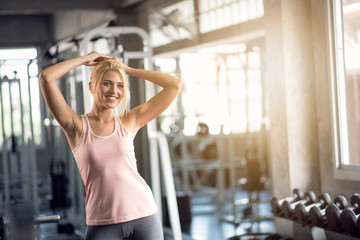 Happy women exercising in the gym