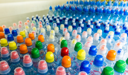 bottles with water, colorful cover
